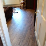 Laying Laminate flooring.