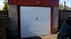 Garage door with 2 coats of paint.
