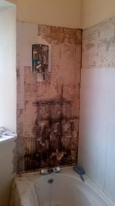 Mouldy wood behind old tiles