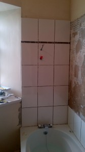 Tiling new tiles around Shower fitting