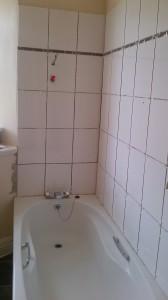 Tiling remainder of bath