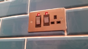 Grouting around new socket faceplate