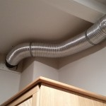 Ducting secured to the wall