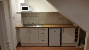 Galley Kitchen installed and tiles and shelf fitted